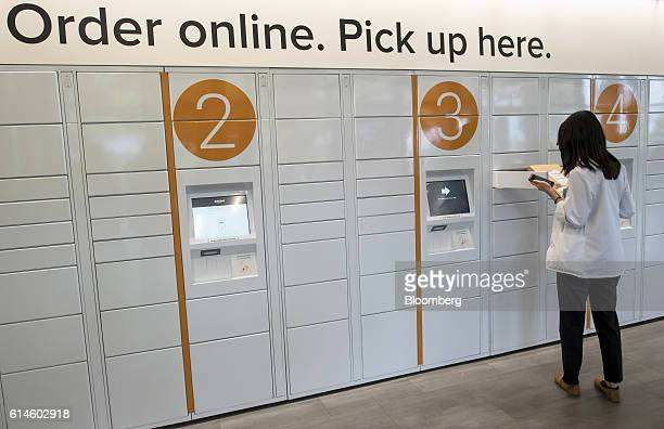 A student retrieves a package at the Amazoncom Inc kiosk on the University of California Berkeley campus in Berkeley California US on Wednesday Oct...