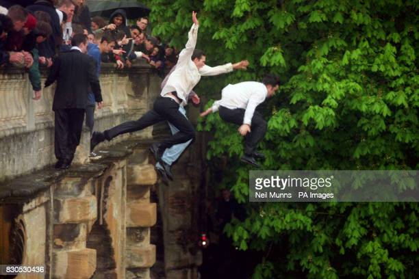 Student revellers jump from the Magdalen Bridge in Oxford in to the Cherwell River for the traditional celebration of the 1st of May