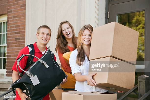 Student Roommates Moving into College Dormitory Apartment on University Campus