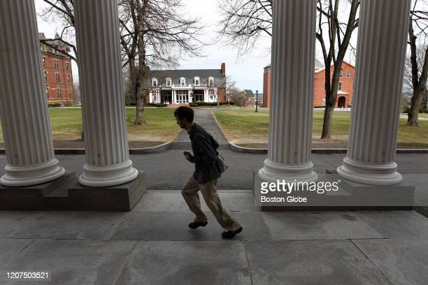 Student runs along Tufts University's campus in Somerville, MA on March 25, 2010.
