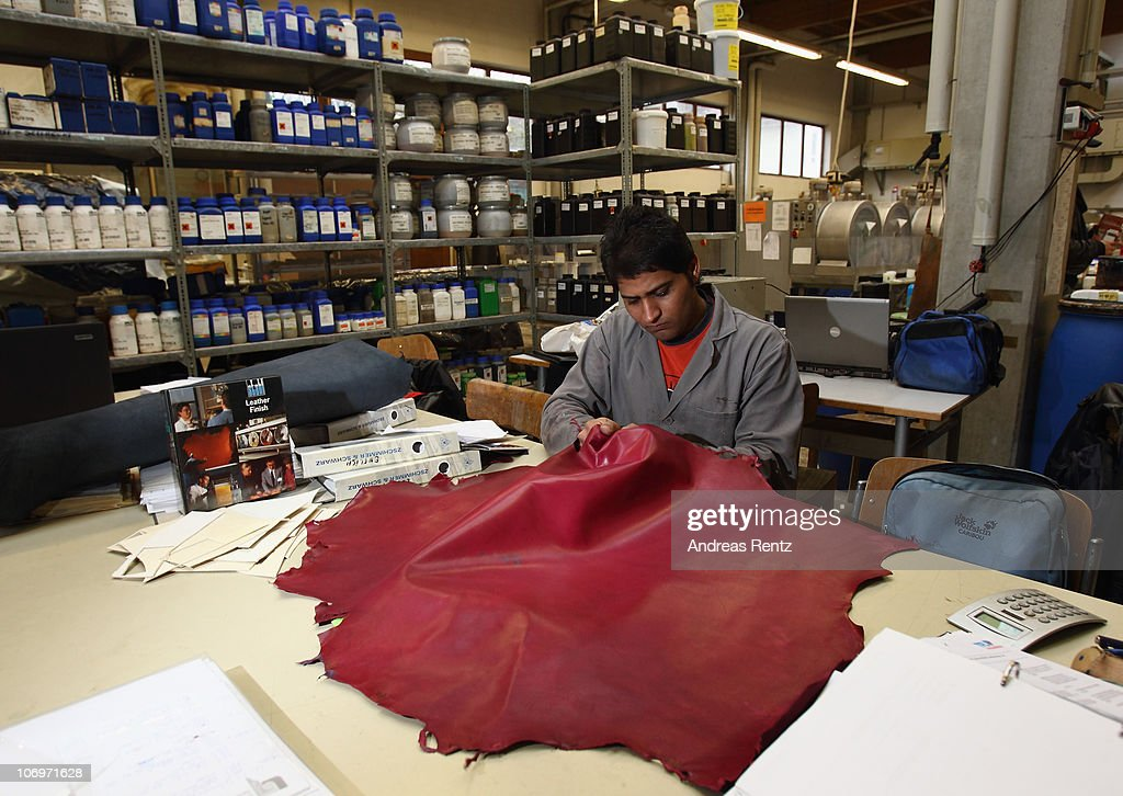 Student Saqib Nawaz controls a coloured tanned leather at the LGR (Lederinstitut Gerberschule Reutlingen) tannery school on November 17, 2010 in Reutlingen, Germany. The LGR school, established in 1954, is among the few tannery schools left worldwide in a profession that some see as dying out. Demand for LGR training, however, is high, and 40% of LGR students come from abroad. The school has invested heavily into high-tech processes that allow precision engineering of leather products as leather products are rising annually by 10% worldwide. The LGR school is located in southwestern Germany in a region with a rich tradition in leather and textile manufacturing.