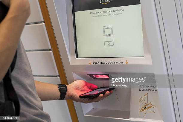 A student scans a bar code to retrieve a package at an Amazoncom Inc kiosk on the University of California Berkeley campus in Berkeley California US...