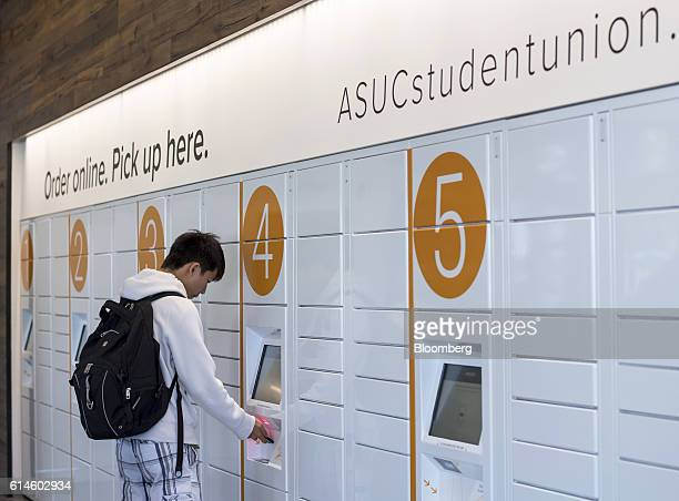 A student scans a bar code to retrieve a package at the Amazoncom Inc kiosk on the University of California Berkeley campus in Berkeley California US...