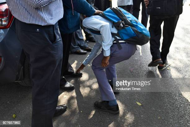A student seeks the blessings of his parents before the class X and XII CBSE board exams outside examination centre at Kendra Vidyala Gole Market on...