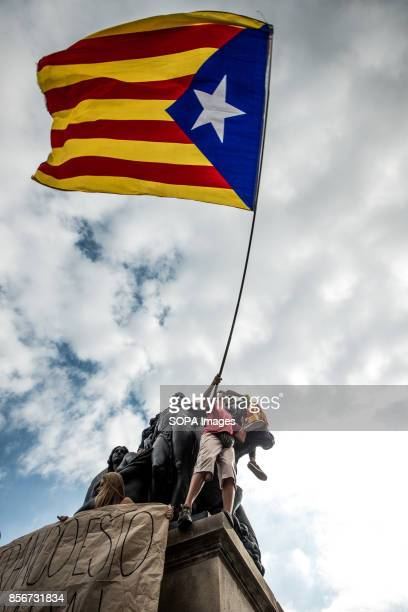 Student seen holding a Catalan flag Students hold a silent protest against the violence that marred yesterday's referendum vote outside the...