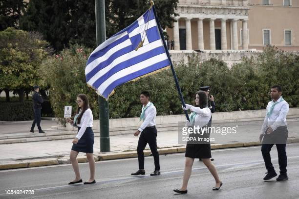 A student seen holding a flag as they take part during the celebrations The national Oxi Day commemorates the rejection by Greek Prime Minister...