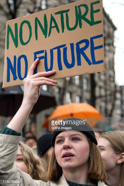 A student seen holding a placard during the Earth Strike in Warsaw Thousands of students and pupils skipped classes and marched through Warsaw to...