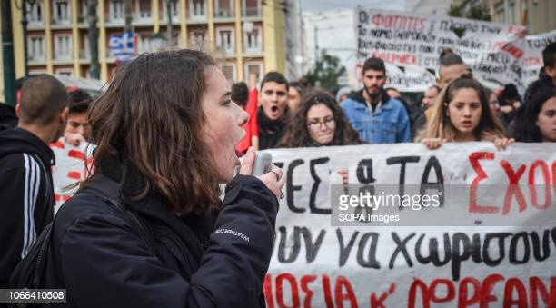 A student seen shouting slogans during the protest Hundreds students took part in a protest march against the agreement reached by Greece and...