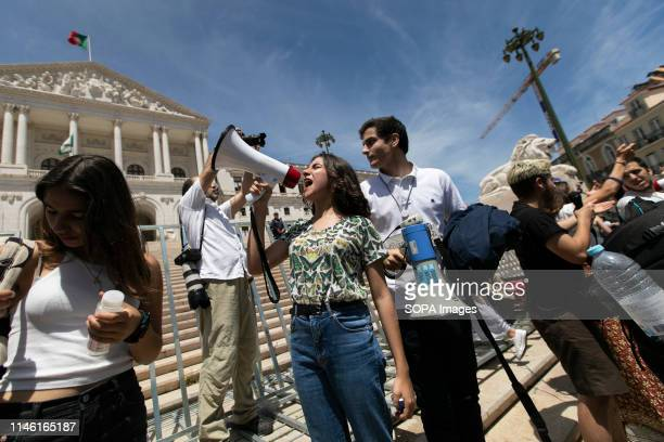 A student seen shouting slogans on a megaphone in front of the Portuguese parliament during the protest Thousands of Portuguese students joined the...