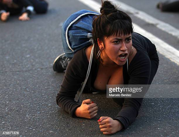 A student shouts and crawls on the street during a protest to demand more participation of students and teachers on the educational reform process on...