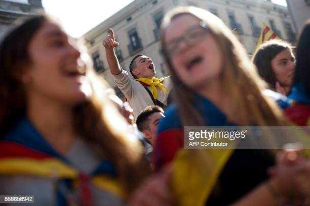 Student shouts during a protest in front of the Generalitat Palace in Barcelona on October 26, 2017. Thousands of Catalan activists protested in...