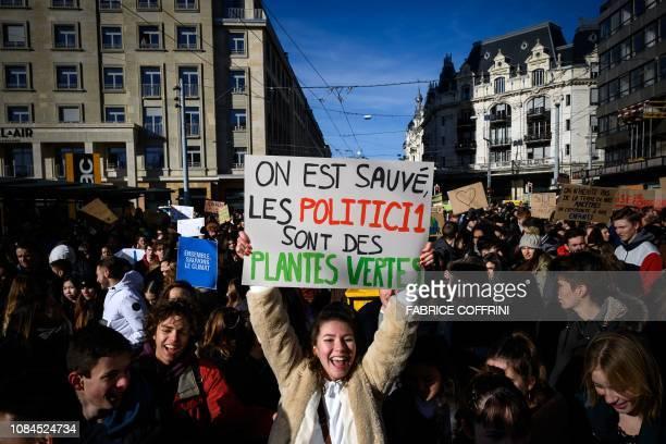 TOPSHOT Student shows placard reading 'On est sauves les politiciens sont des plantes vertes' in a protest against climate change during a strike on...