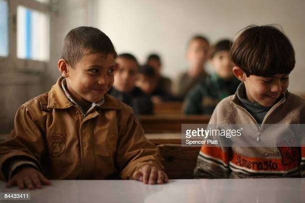 Student sit in class at Jabalia Prep C Boys School on the first day back to school since the cease-fire with Israel January 24, 2009 in Jabalia, Gaza...