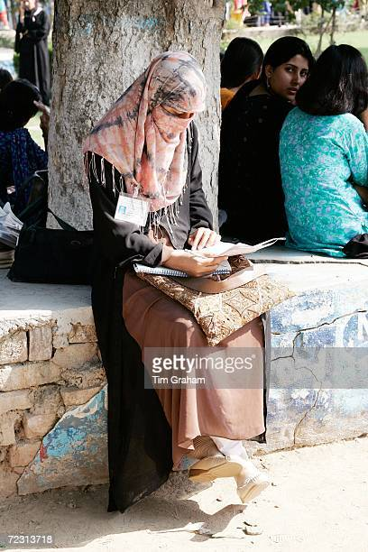 Student sits reading during the royal visit to the all female Fatima Jinnah University on October 31, 2006 in Rawalpindi, Pakistan. Prince Charles...