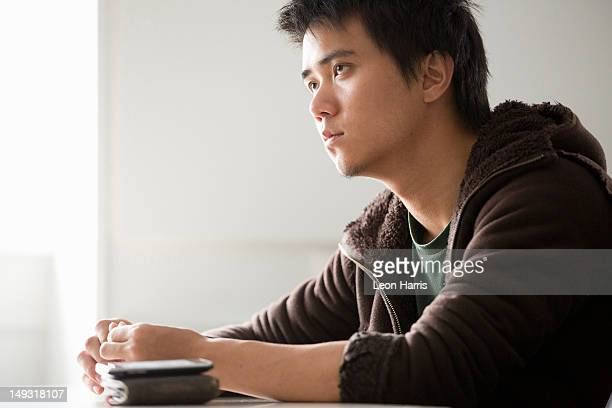 student sitting at desk in class - 男性一人 ストックフォトと画像