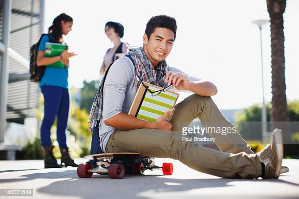 student sitting on skateboard outdoors - philippines stock pictures, royalty-free photos & images
