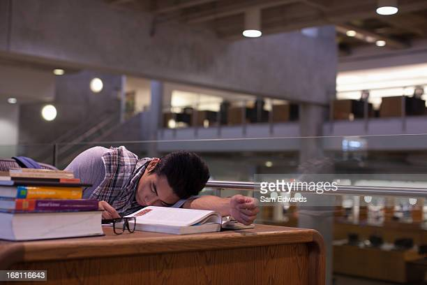 Student sleeping in library