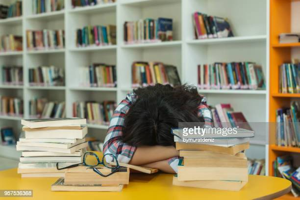 student sleeping on books - girl mound stock pictures, royalty-free photos & images