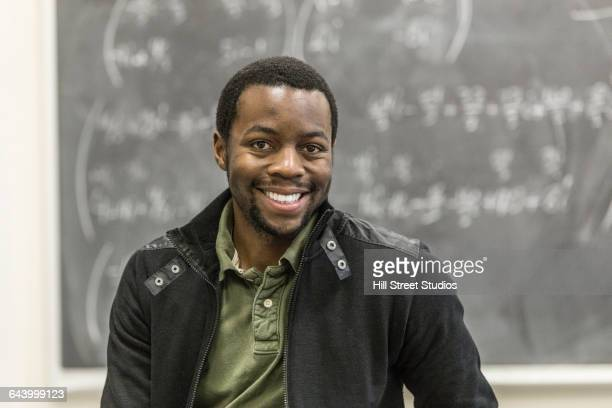 Student smiling in college classroom