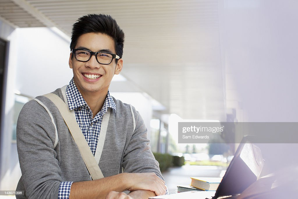 Student smiling outdoors : Stock Photo