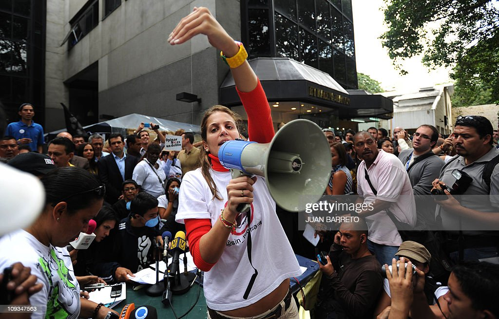 A student speaks on a loudspeaker during : News Photo