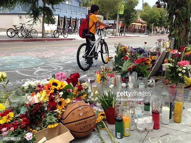 Student stops to view the makeshift memorial in front of the IV Deli Mart in Isla Vista, California, where UCSB student Christopher Michaels-Martinez...