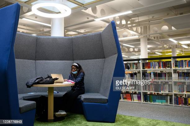 Student studies in Coventry University Library whilst observing social distancing regulations at the beginning of the new academic year at Coventry...