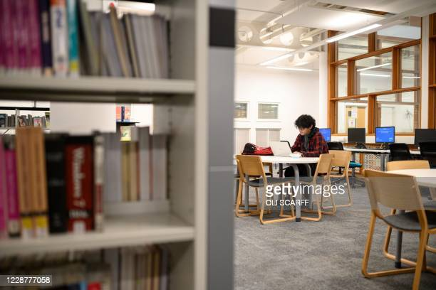 Student studies in Coventry University's Alison Gingell building whilst observing social distancing regulations at the beginning of the new academic...