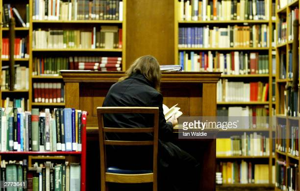A student studies in the main library at the University College London on December 1 2003 in London British Prime Minister Tony Blair faces mounting...