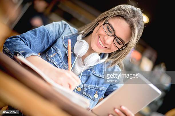 Student studying at a cafe