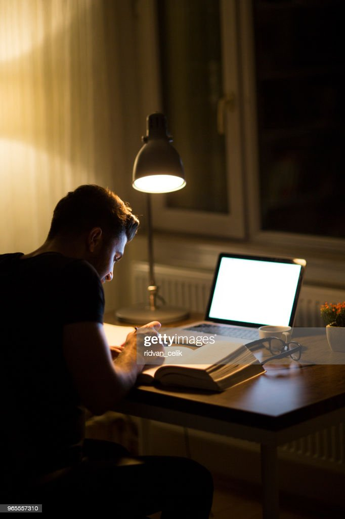 Cool Student Studying At Night With A Desk Lamp On High Res Stock Squirreltailoven Fun Painted Chair Ideas Images Squirreltailovenorg