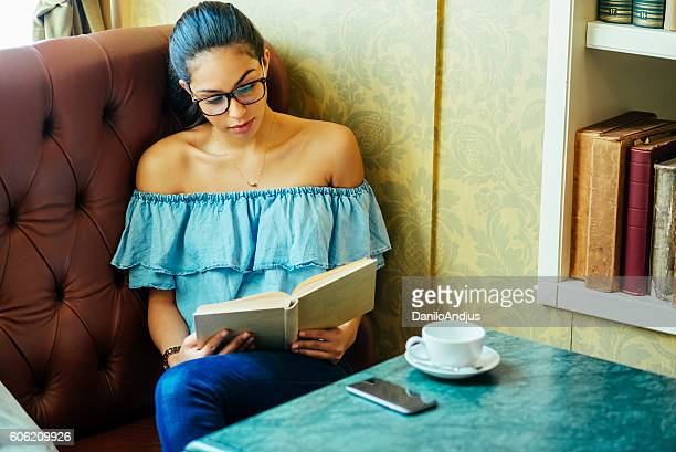 student studying in a coffee shop
