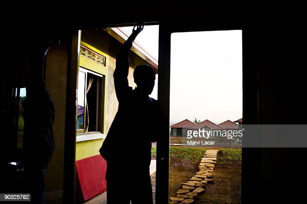 A student takes a break inside the boys dorm after school at the Agahozo Shalom Youth Village on March 12 2009 in Rwamagana Rwanda The ASYV provides...
