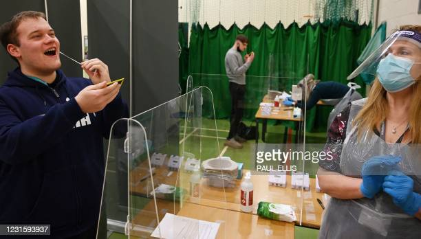 Student takes a Covid-19 Lateral flow test in the sports hall of Wilberforce college in Hull, northeast England on March 8, 2021 as schools reopen...
