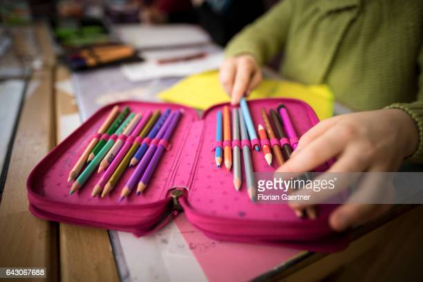 Student takes a pen from his pencil case. Feature at a school in Goerlitz on February 03, 2017 in Goerlitz, Germany.