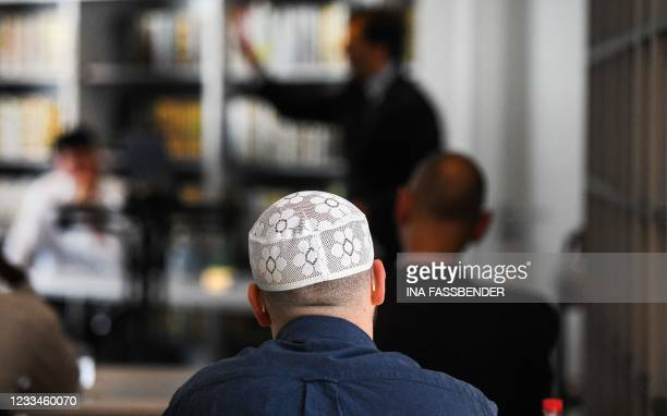 Student takes part in a Qur'an recitation lesson at the Islamkolleg Deutschland in Osnabrueck, western Germany on June 14, 2021. - The first block...