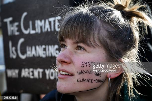 TOPSHOT A student takes part in a school strike for climate held on the sidelines of the World Economic Forum annual meeting on January 25 2019 in...