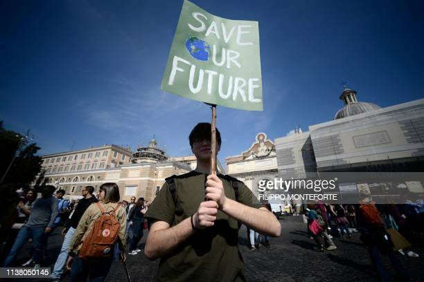 Student takes part in the Fridays For Future rally in Piazza del Popolo in Rome on April 19 to demand action to prevent further global warming and...