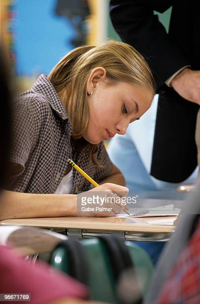 student taking a test in school