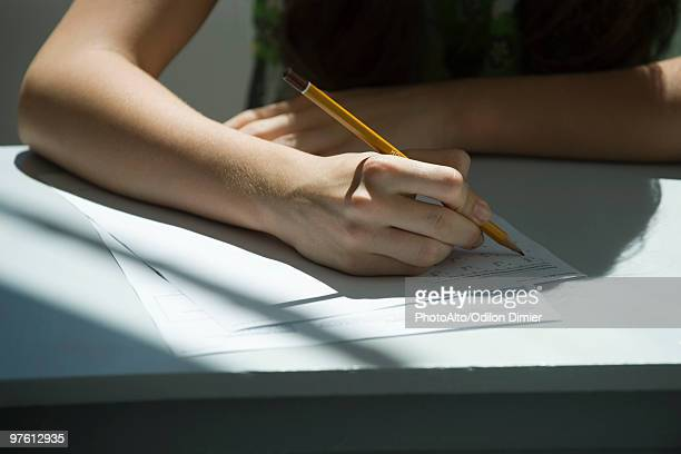 student taking math quiz, cropped - educational exam stock pictures, royalty-free photos & images