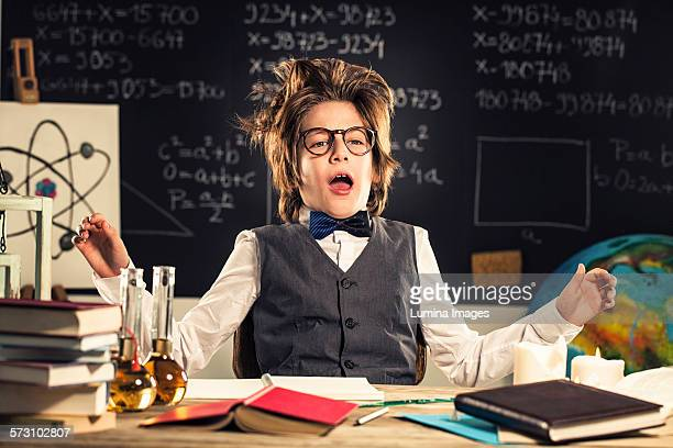 Student talking at desk in classroom