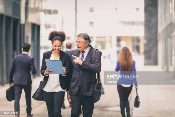 Student talking with a senior businessman