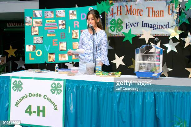 A student talks about lovebirds at the 4H Club public speaking competition at MiamiDade County Fair