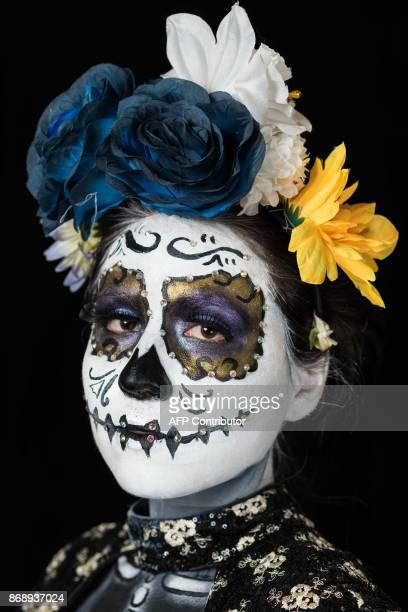 Student Tania Farias Rivera poses for a photograph disguised as Catrina during a Catrinas competition at the University of Michoacan in Morelia...