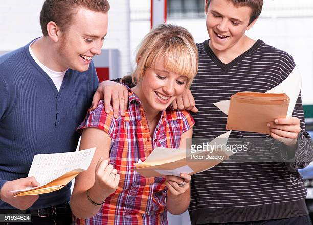 student teenagers opening good exam results - day stock pictures, royalty-free photos & images