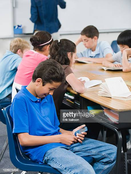 Student texting in classroom