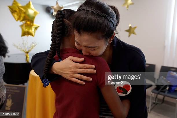 Student Thalia Brown hugs Anchesa Bunyasai at Children of Promise Preparatory Academy in Inglewood CA March 3 2016 Anchesa Bunyasai was married to...