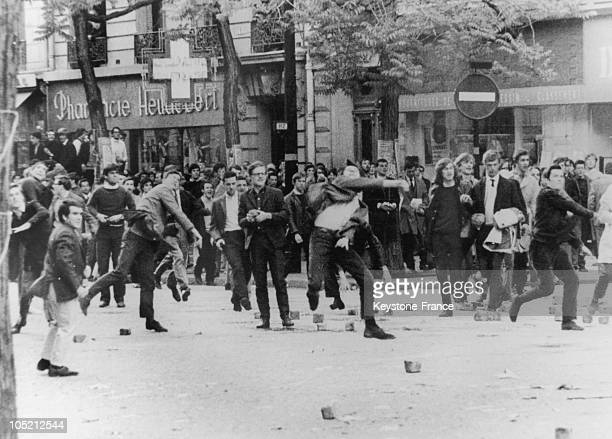 Student Throwing Projectiles At The State Security Police In Paris In May 1968