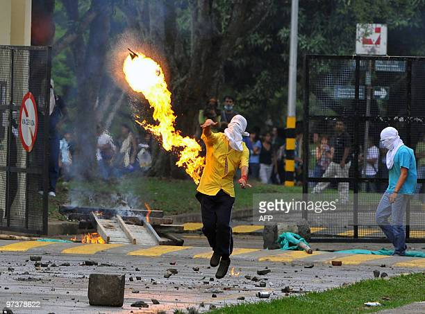 A student throws a molotov cocktail during a protest against a reform in the health care system launched by the govermnment at the Universidad del...