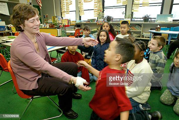 Student Tony Hill gets up to give a hug to Lori Lentini Literacy Coordinator at the Drewicz Elementary School in Lynn who stopped by the 1st grade...